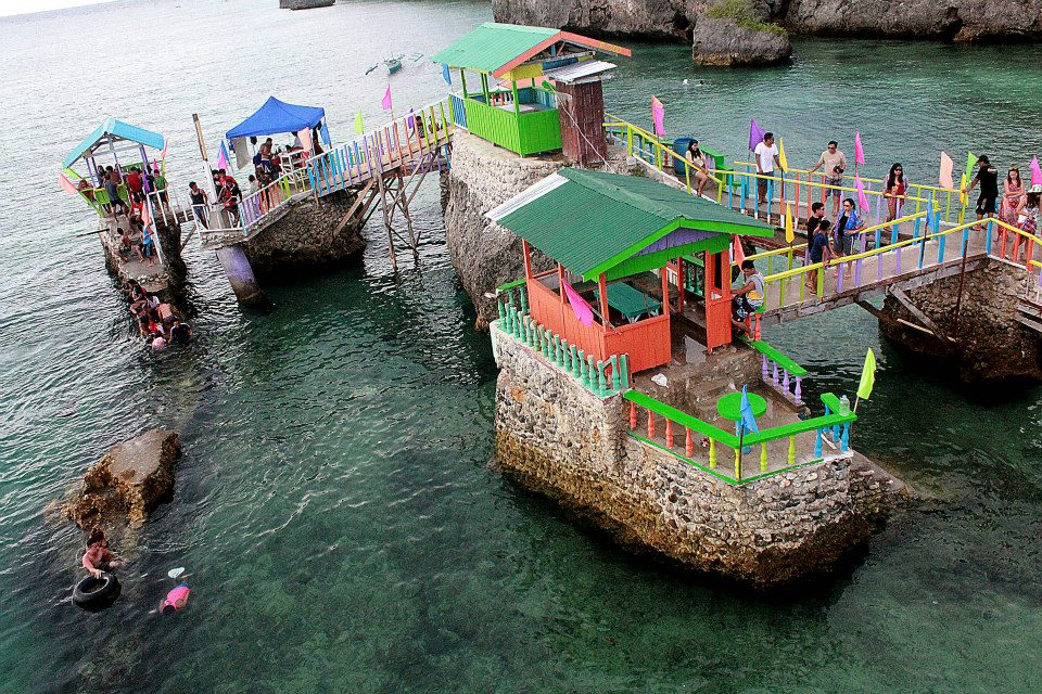 colorful cottages atop the island's huge rock formations