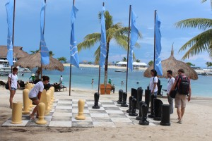 us playing with their life-sized chess board