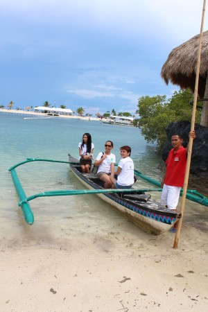 taking the paddle boat on our way to the private island
