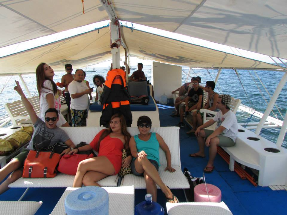 lounging comfortably in the clean and spacious boat
