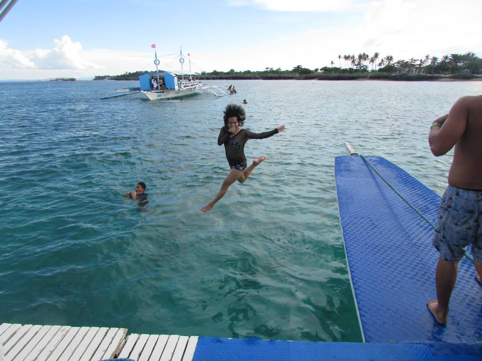 taking a refreshing dip into the enticing waters while the boat is docked near Olango Island