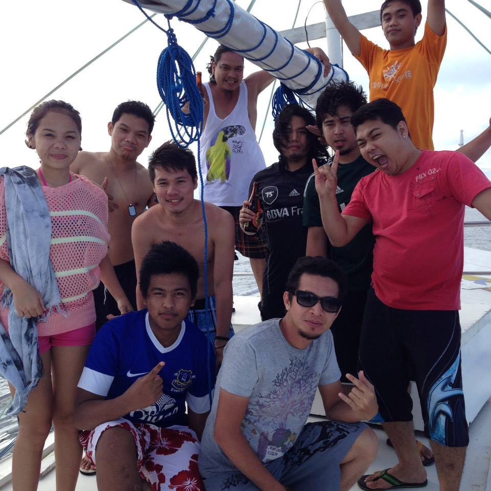 group pic on the boat's rooftop