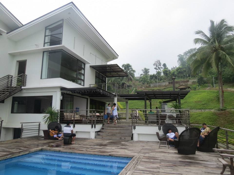the facade of the rest house with a glimpse of the outdoor pool
