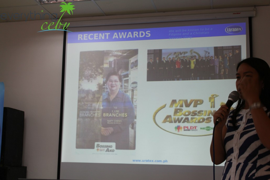 Ms Marvey Alcantara (Consumer Marketing Manager), showing the Cebu media a slide of one of their recent achievements, the recognition of Mrs. Natividad Cheng (Uratex's CEO) in the PLDT-SME Nation's MVP Bossing Awards