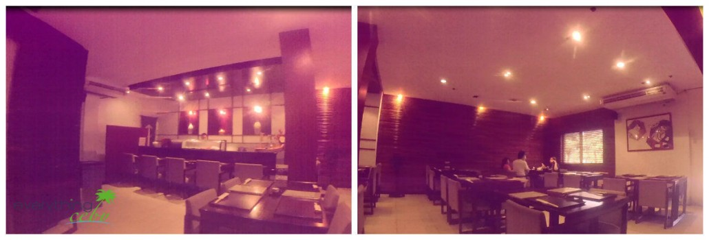 Further inside, there's a sushi bar that has dim lights and tables.