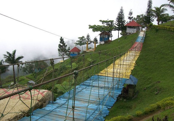 the long, colorful hanging bridge found in one of the mountain resorts along Transcentral