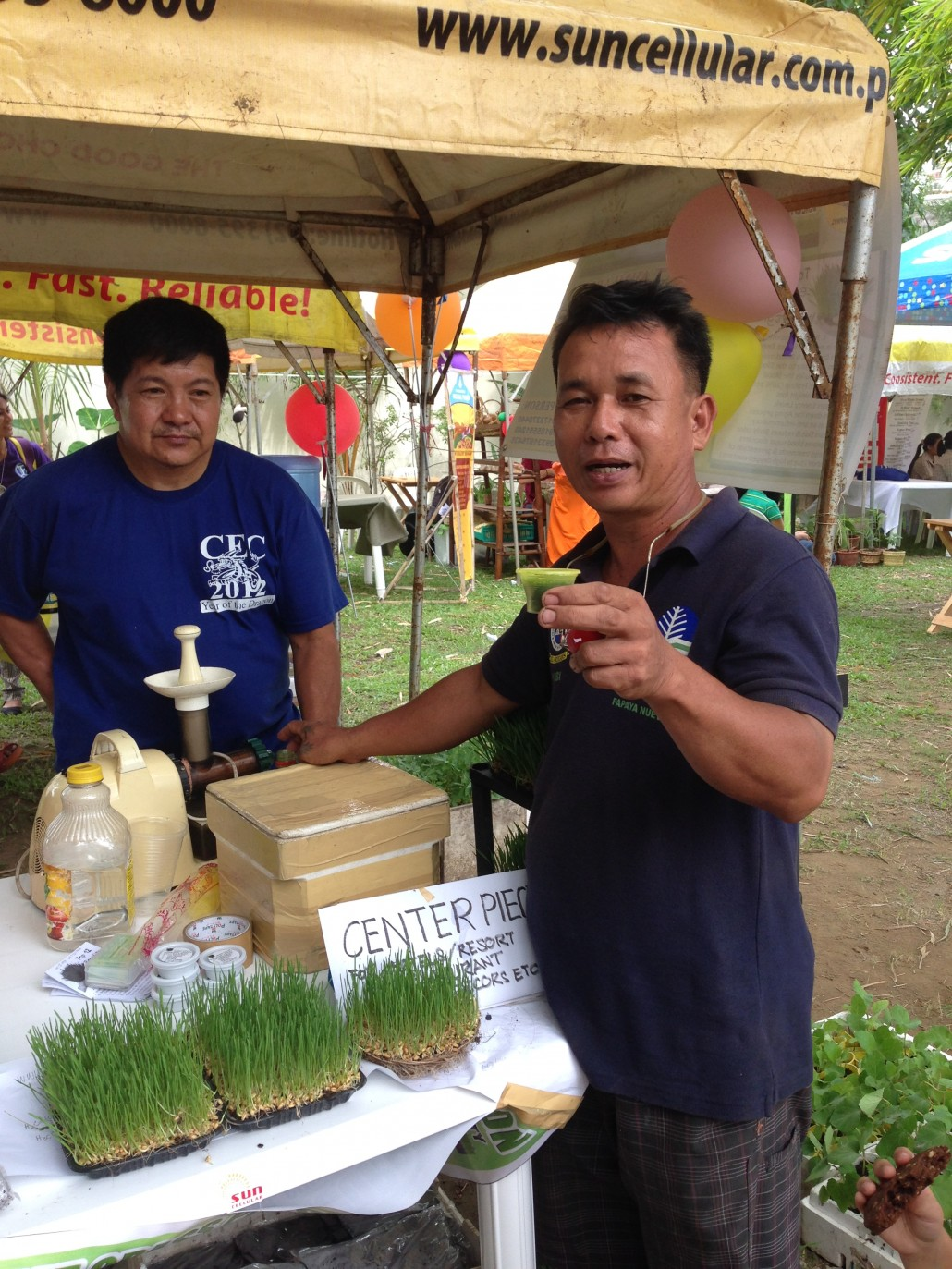 a booth displaying wheatgrass products and discussing its many benefits
