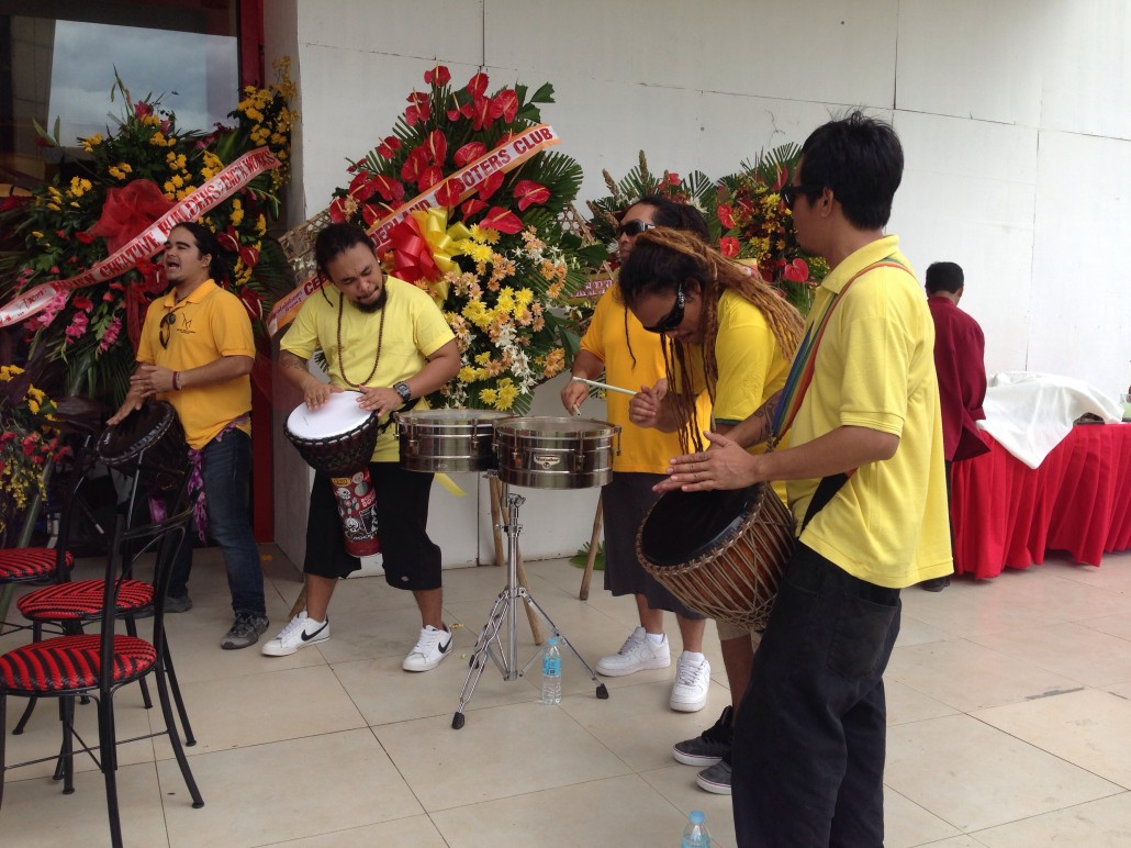 a percussion band playing some groovy music to set the mood during the restaurant's opening