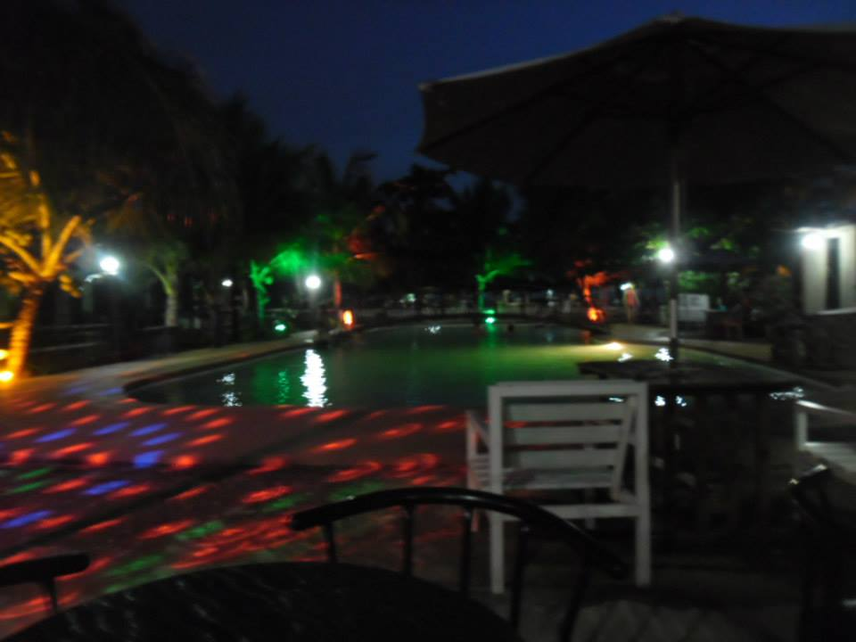 their party-conducive poolside with disco lights