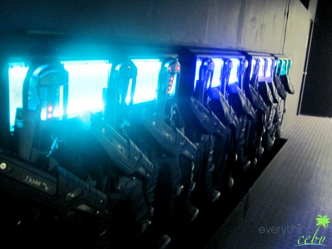 The guns and vests displayed just outside the laser tag arena.