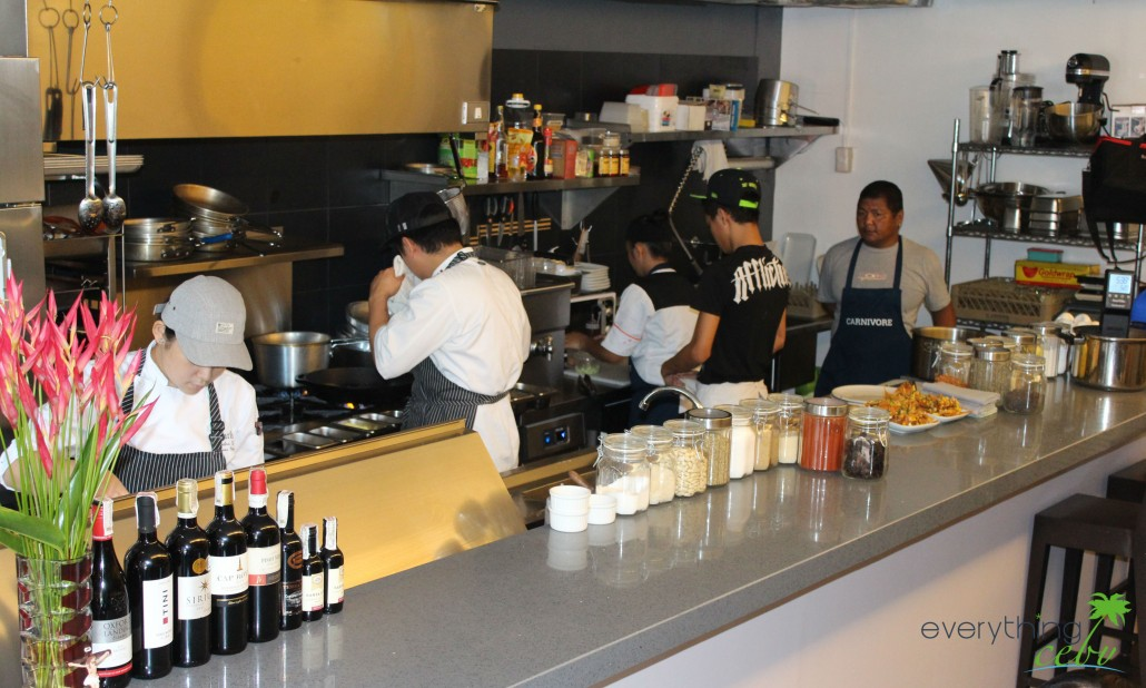 Carnivore's open kitchen with their diligent staff and dynamic chefs/owners
