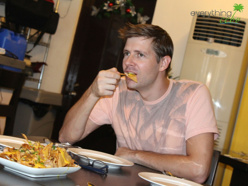 Jason (owner of Everything Cebu) enjoying the nachos