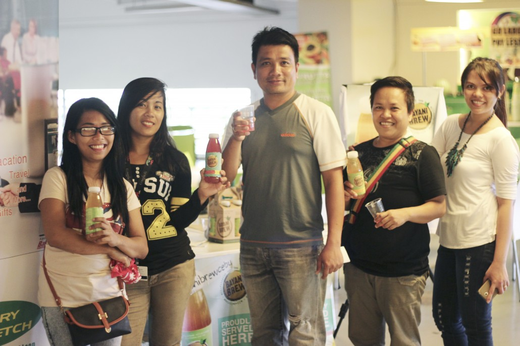 Happy and satisfied-looking  Bayani Brew customers during a taste test in IT Park