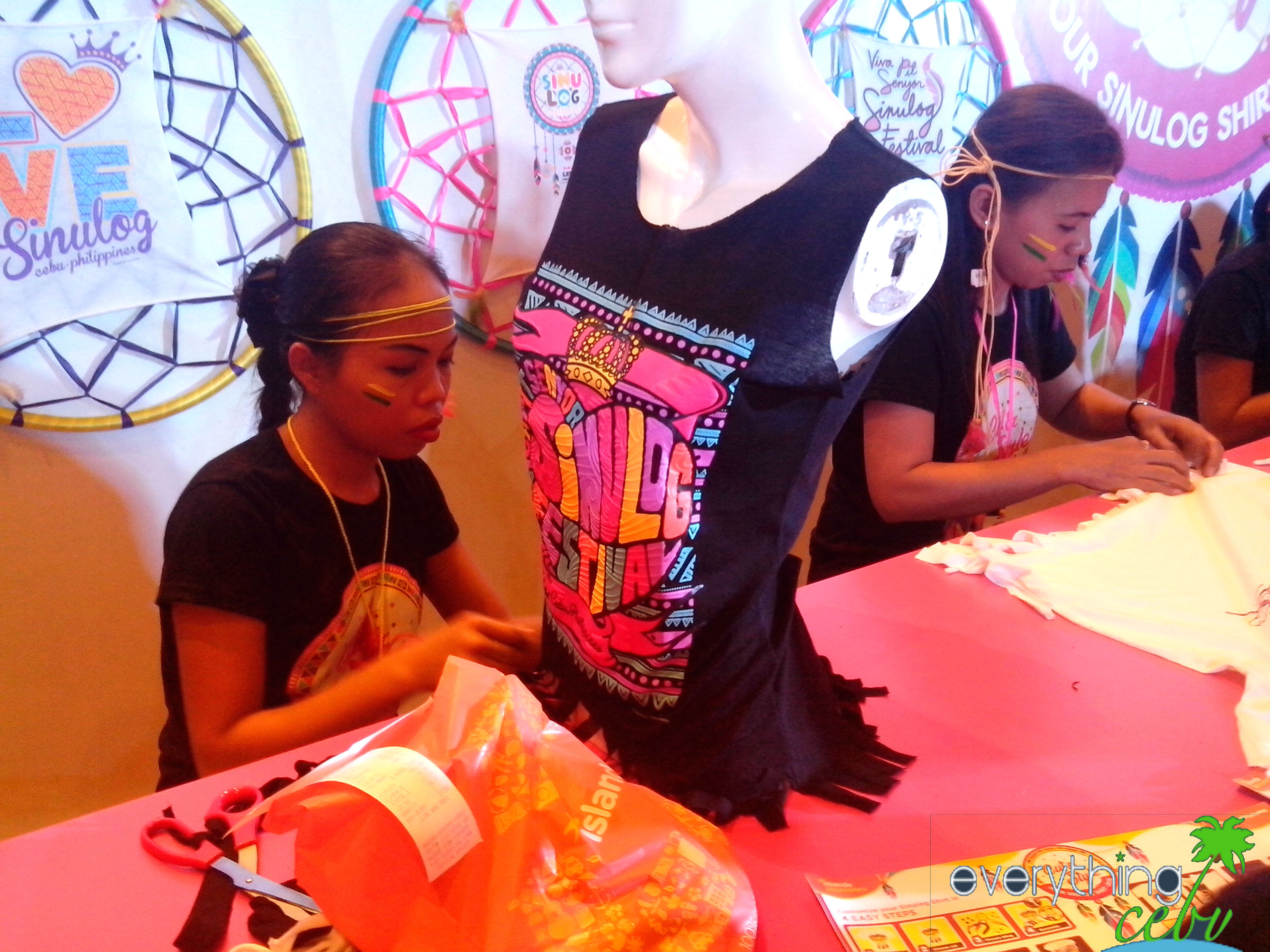 TESDA dressmaking students styling the Sinulog shirts for Cut and Style 2015.